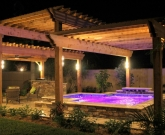 Spa with custom pergola at night