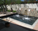 Island Stone tile, Niagra, Elevated Water feature, black pebble, Brick pavers